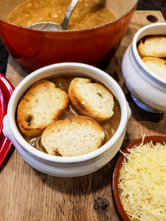 add toasted baguette slices on French onion soup