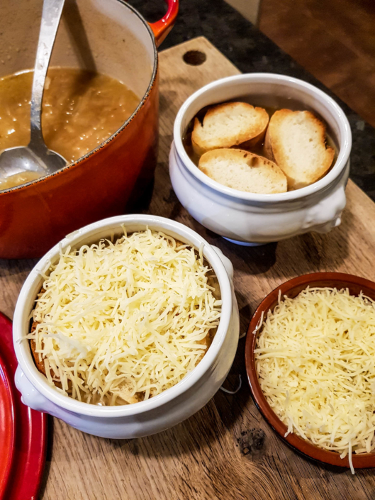 french onion soup toasted baguette slices and shredded cheese