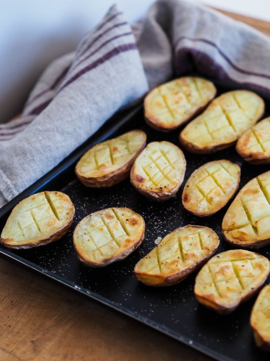 pommes de terre x cuites au four avec une noix de beurre