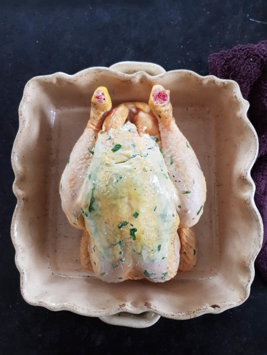 French cooking technique with herb butter under the skin